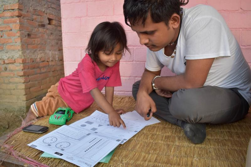 A child being assessed in a household in Sindhupalchok District in Bagmati Province, Nepal
